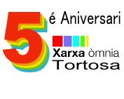 Logotip 5è aniversari Xarxa Òmnia Tortosa